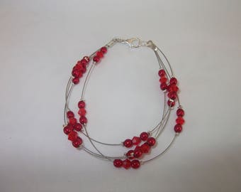 Crystal and red glass beads bracelet