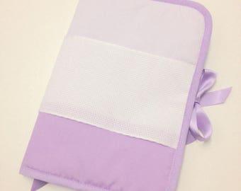 Health book has cross-stitch fabric purple