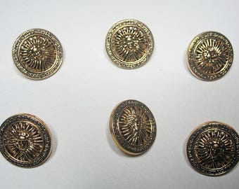 Round gold button with Sun King head