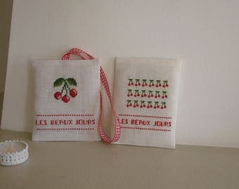 Linen white and decorative pillows cherries