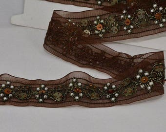 Lace, embroidered with bronze sequins and white beads 40 mm