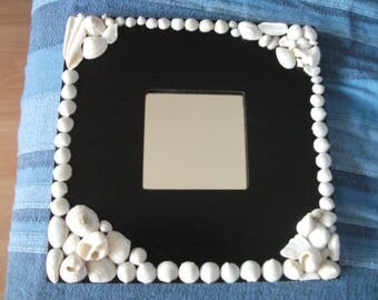 Mirror black frame with white whole shells and pieces of white shells