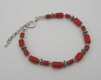 Coral and silver bicone glass beads bracelet