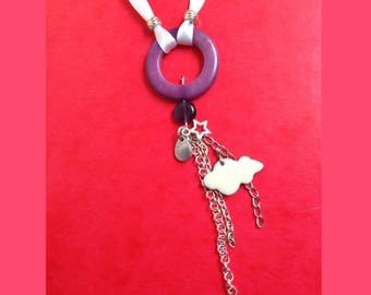 double white long necklace purple vegetable ivory ring and Ribbon