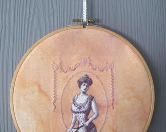 Round medallion with early 20th s lingerie embroidery.