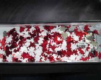 set of red and white Santa table confetti