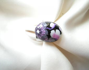 Ring of purple and black flowers.