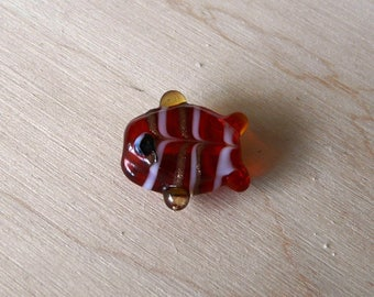 Fish shaped red lampwork glass bead