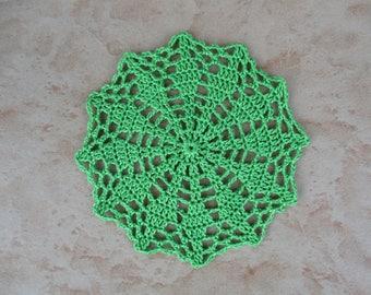 small green round crochet doily