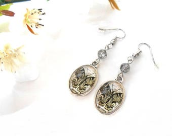 Oval glass cabochon with a butterfly and a gray Swarovski Crystal bead earrings
