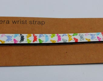 strap way white webbing and butterflies multicolor