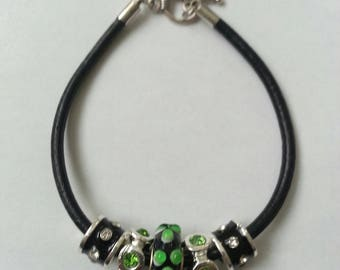 Black leather bracelet, rhinestones and glass bead