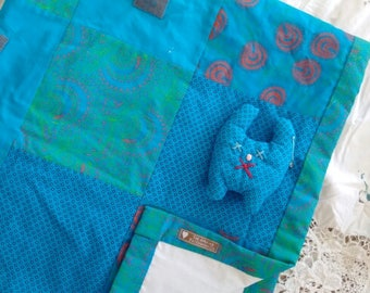 Baby quilt, blue and turquoise with soft toy. Swe-Swe cloth from Africa.