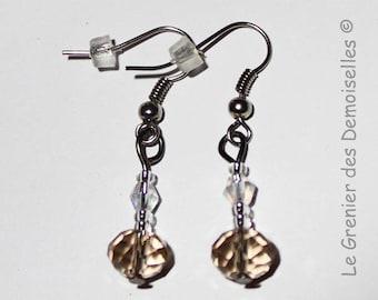Pair of beige Crystal dangling earrings