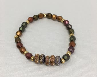 Amber, Copper, Rust, Gold and Green beaded bracelet with gold accent pieces