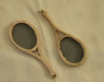 Tennis racket pendent, hand carved from wood