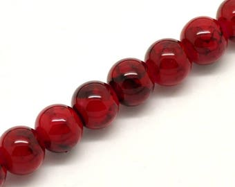 25 8 mm black marbled red glass beads.