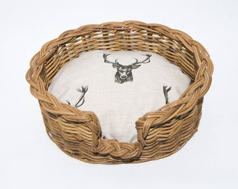 Traditional Wicker dog Basket with classic,Scottish deer stag pattern cushion.