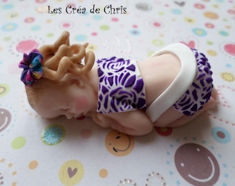 baby girl onesie decorated with polymer clay.