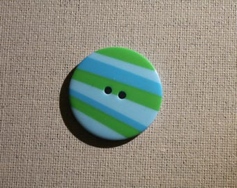 in shades of blue/green plastic button