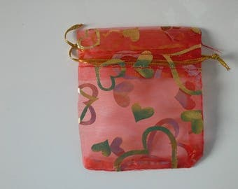 5 red organza bags
