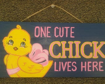 ONE CUTE CHICK sign