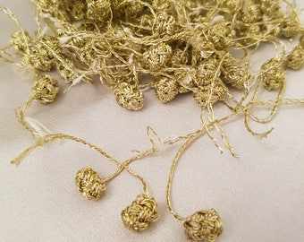 Buttons Aakads Moroccan gold and white bicolor braided in vegetable silk thread - remaining