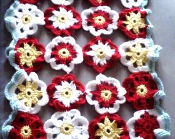 Daisy doily crocheted in multicolor wool