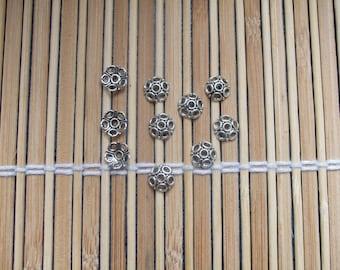 10 silver metal caps