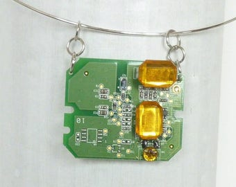 Green piece of electronic rectangular pendant.