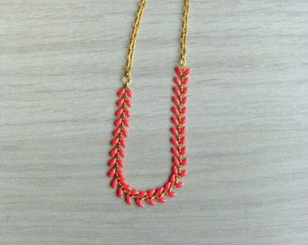 Gold plated necklace with red/coral ear chain