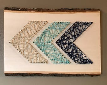 Chevron arrow string art on tree bark plaque