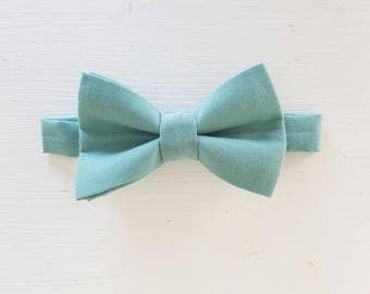 Bow tie child prenoue dark green with water
