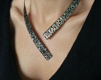 """Simple """"pinstripes"""" necklace on black with silver foil"""