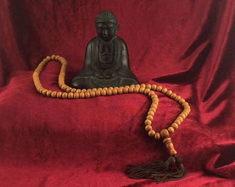 Buddhist-style long sandalwood mala with brown tassels