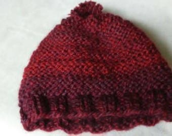 Hand knit winter hat made from chunky acrylic yarn.