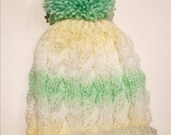 Green baby's bobble hat
