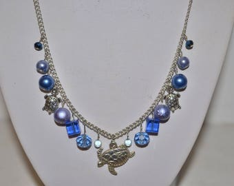 Blue and silver turtle necklace