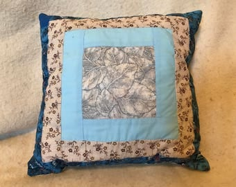 Earthy blues and browns throw pillow