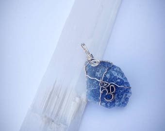 Wire wrapped stone with Om charm
