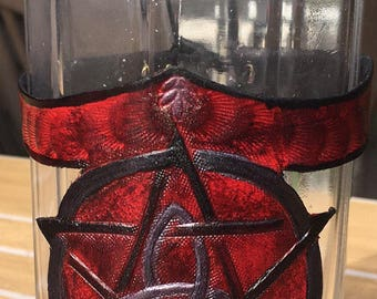 Bottle glass with decorative leather