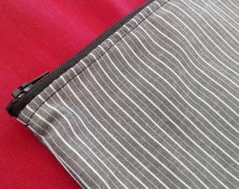 Grey striped clutch bag