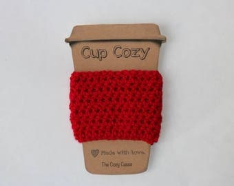 Red coffee cozy that supports ending hunger