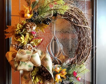 Grape vine wreath and green mums with tied  pine cone burlap ribbon