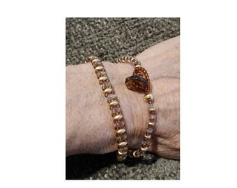 """Wrap bracelet with button closure.  1/4"""" wide, wraps twice around a 6"""" wrist."""