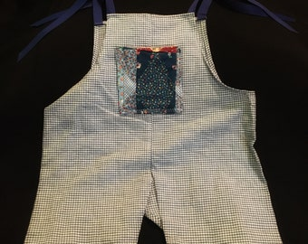 Blue gingham romper with patchwork pocket