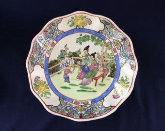 Chinese Famille Rose Plate Qianlong Nian Zhi Mark Child Offering Flower