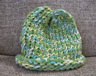 Green, Blue, Yellow, and White Baby's Knit Hat