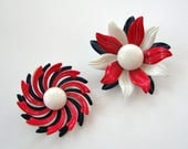set of 2 large vintage enamel flower pins . patriotic flower brooches, red white and blue petals . mod daisy and pinwheel flowers