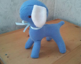 Lamb for baby boy nursery in blue n white fleece. Safety lock eyes and nose. Hypoallergenic stuffing. Measures 9 inches high.